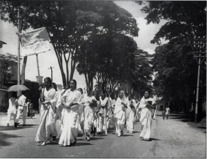 21st February morning, 1953. Female students of Dhaka University, festoons in hand in the procession.