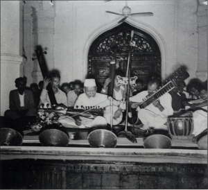 Ustad Alauddin Khan playing sarod in a recital in Curzon hall, accompanied by Ustad Khadem Hossain Khan on sitar. Winter of 1955.